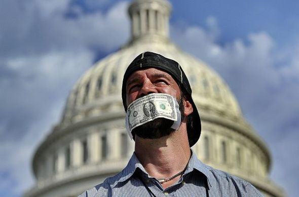 dollar bill taped to man's mouth in washington, dc