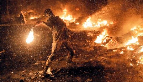ukraine protester with molotov cocktail