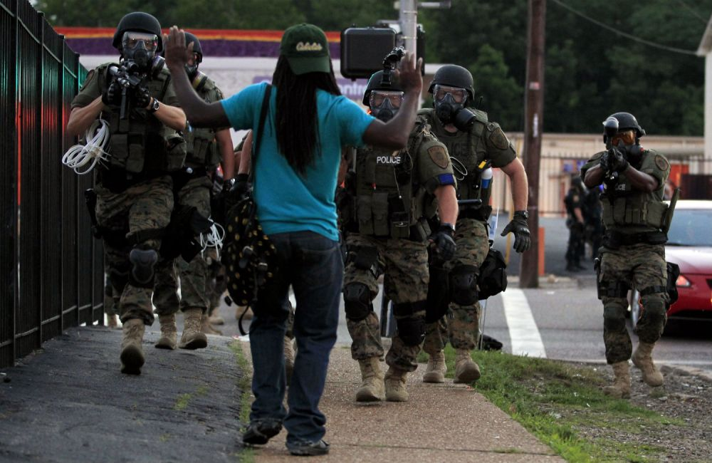 ferguson police guns drawn on civilian
