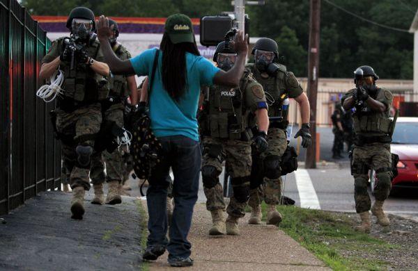 ferguson police guns drawn on civilian