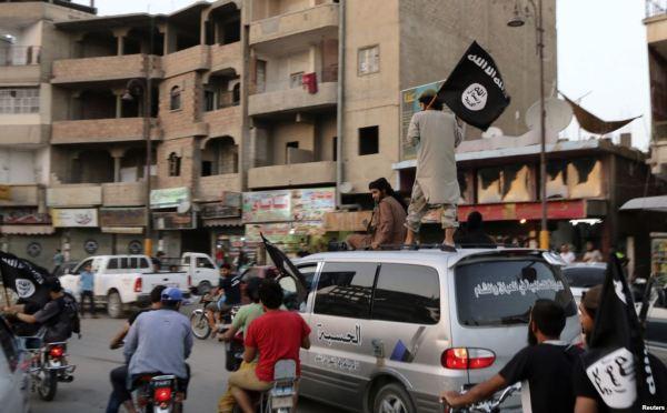 members loyal to isil drive around Raqqa