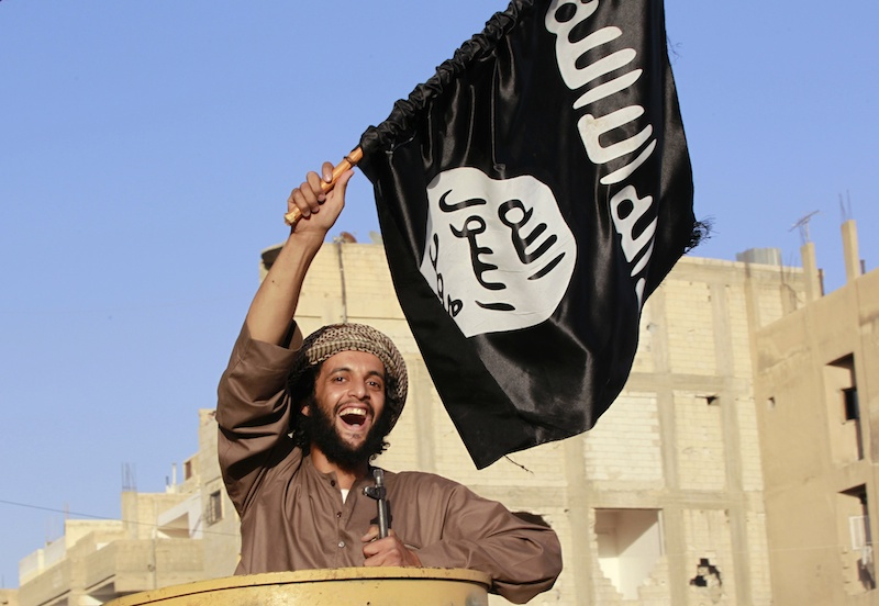 isil-fighter-with-flag-reuters