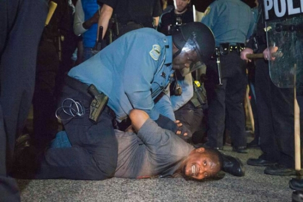 us justice department says city of ferguson has racist practices