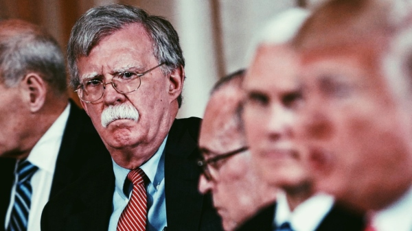 Former National Security Advisor John Bolton, pictured in the background, with President Donald Trump in the foreground. Bolton's new book alleges that Trump is unfit for office. Posted by kambui on mentalunrest.