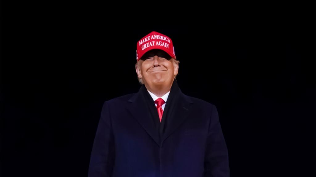 donald trump wearing maga hat in a dark background
